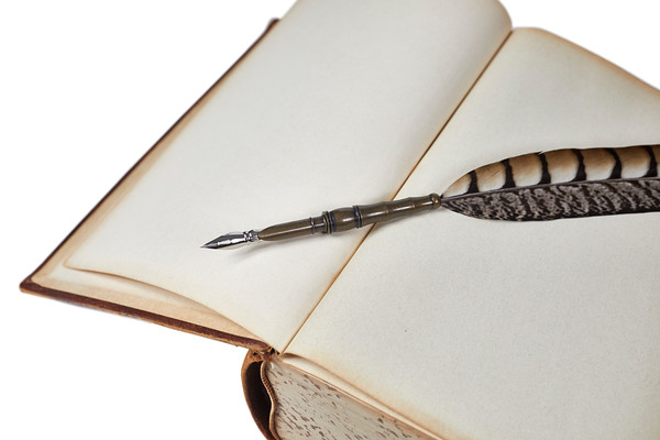 Vintage Book with a Quill Pen