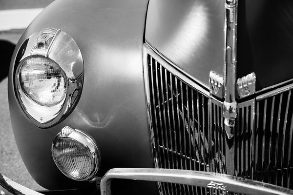 Close up of the front half of an antique car