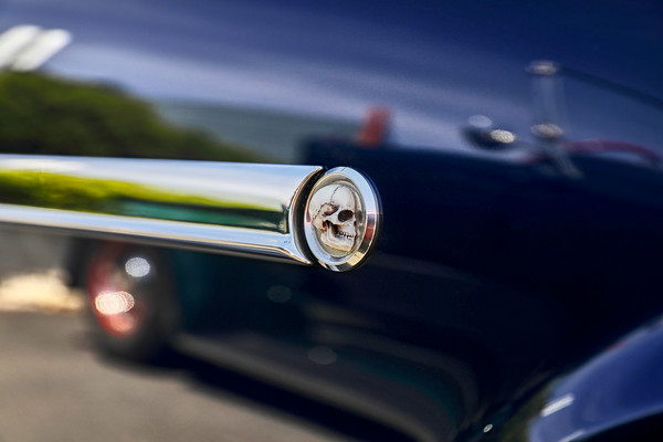 Close up of a skull on the side trim of an antique car