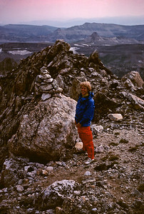 Larry christens the cairn on the Valhalla Traverse.