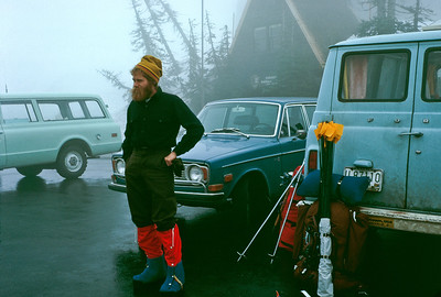 "Here I am in the parking lot by the Paradise Ranger Station. Note the Jensen pack and the 'super gaitors' that I made myself (because I was too cheap to buy the ones made by Great Pacific Ironworks). My van, the blue one on the right has a "" Dinkytown USA"" sticker "" Where It's At"""