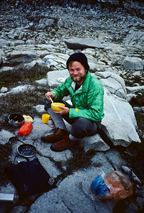 "Mountain breakfast on the rocks: My guess is that I'm eating instant oatmeal. The green jacket was a prototype with a quilted insulating fabric construction that we called ""Silver Lining"" when we commercialized it. We obviously didn't use yellow Velcro on the production versions."