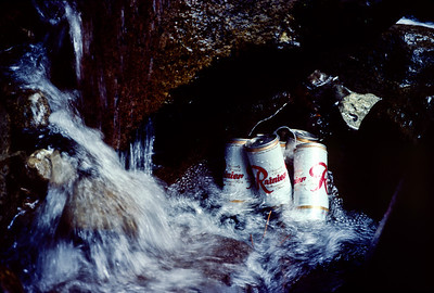 "Vitamin ""R"", stashed in the stream near the trail head, waiting to celebrate our return. Often these beer stashes would be plundered by inconsiderate opportunists. But today we were fortunate and our thirst was quenched."
