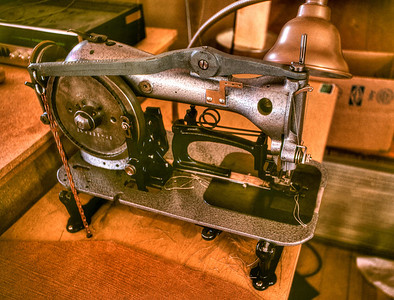 This sewing machine was set up like a bar tacker to stitch the leather 'dumbell' shaped lashing loops that were sewn on all Jensen packs. It was a signature feature of the pack and this machine was custom made for that purpose. The stitching pattern was a circle with an X cross stitch. This machine was the only one in the world and I believe that it was an Adler.