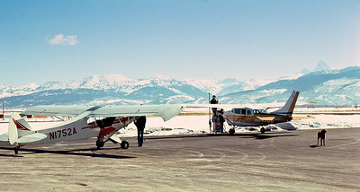 Jay refuels the Cessna while Larry watches.