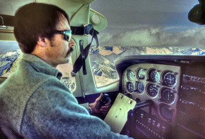 Jay Kelly flying the Cessna over the Cascades on the way to the airstrip at Driggs, Idaho.