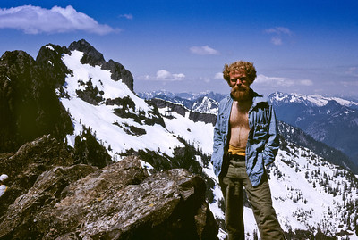That's me, Bill Edwards, on the summit of The Tooth. What a beautiful clear day. I'm happy just to be here instead of sitting behind the desk at NBBJ (the architectural firm where I worked in the early 70's). Chair Peak in the background