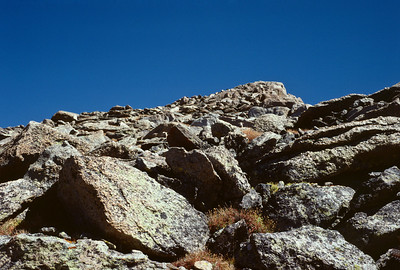 Can you find the two sheep in this photo? They are peeking out from the rocks about mid way up.
