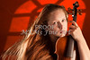 Photograph of Beautiful Woman  Violin Musician Under Window