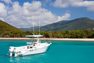 Maybe someday....I've got some lofty ambitions about getting back to the Virgin Islands...some of them include getting my own boat. Better start budgeting now! This photo was taken just off the shores of Smugglers Cove, one of the finest beaches on Tortola. We weren't able to swim ashore, but apparently there's a guy that runs a blender off of his car battery and makes a mean BBC (banana, baileys and coconut)...guess we'll add that to the list for next time!