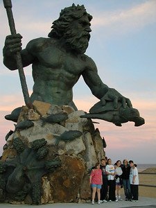 King Neptune towers over the speed skaters.