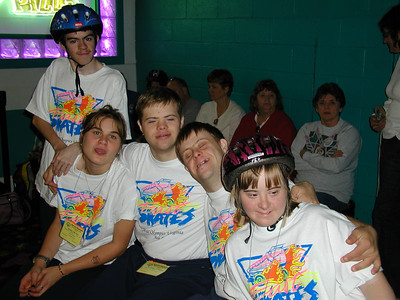 Some of the speed skaters prepare for the competition.  Kelsea's tongue seems to be stuck.