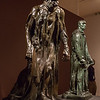 """Rodin: Evolution of a Genius, exhibition of ~200 works of French sculptor Francois Auguste Rene Rodin (Auguste Rodin, 1840-1917), by Montreal Museum of Fine Arts & Musee Rodin in Paris, at Virginia Museum of Fine Arts November 21, 2015-March 13, 2016; includes plaster models, sketches, photos, bronze and marble pieces; photos allowed without flash - used 5D Mark III w/Canon 35/1.4 & UV filter; Rodin considered sketches heart of his work, with most sculpting in marble or casting in bronze done by others, under his supervision; Gallery 8 ends exhibit with several well-known Rodin works,  with large versions of The Burghers of Calais at rear; in 1347, during Hundred Years' War, King Edward III of England offered to spare Calais if any 6 leaders surrendered with ropes around their necks & with keys of city; Rodin won 1884 competition to memorialize sacrifice made by the citizens (burghers, esp wealthy citizens), although in end the 6 were spared at urging of Edward's wife; monument completed 1889, Rodin's rendering controversial as it depicted """"pain, anguish, and fatalism"""", which he felt showed heroic self-sacrifice; the 6 figures somewhat largers than life,  it's among Rodin's most famous works; Eustache de Saint-Pierre, wealthiest among the burghers, is said to have been 1st to come forward to agree to Edward's terms for saving Calais; on right is Jean d'Aire"""
