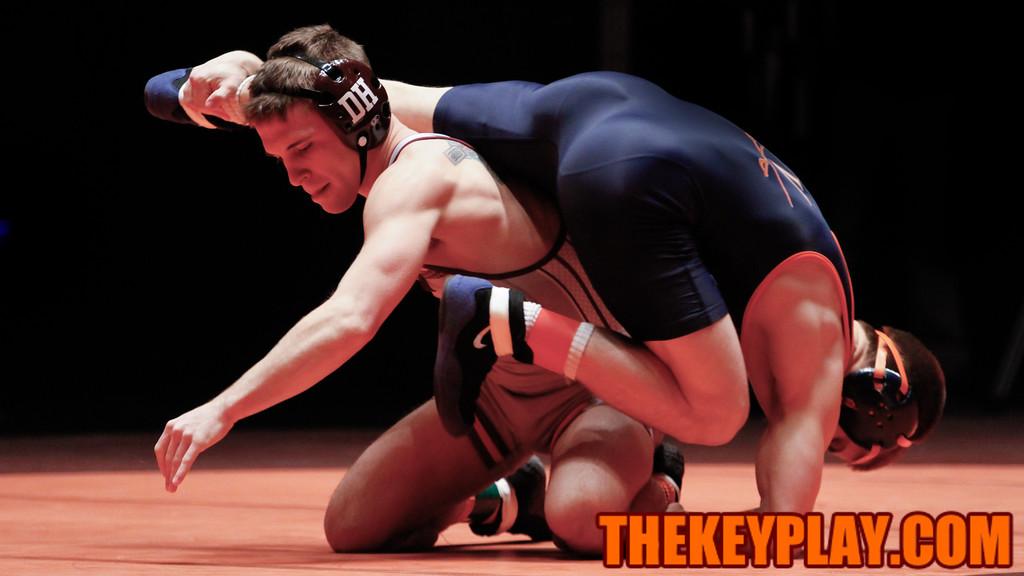 The Hokies' Joey Dance upends UVa's Will Mason in a 14-4 major decision. (Mark Umansky/TheKeyPlay.com)