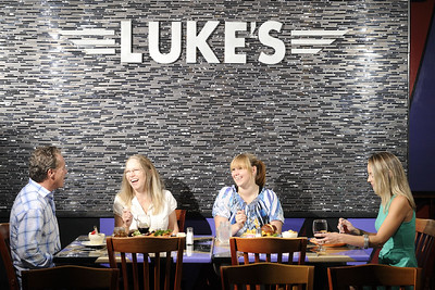 Friends dine at Luke's Cafe, a locally owned rock-and-roll themed restaurant, in Abingdon, VA on Wednesday, September 10, 2014. Copyright 2014 Jason Barnette