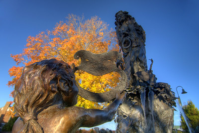A brilliant fall colored tree behind the Midsummer Dream Fountain in Abingdon, VA on Friday, October 24, 2014. Copyright 2014 Jason Barnette