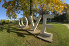 """Brilliant fall colors surround the """"LOVE"""" sign on the lawn of the Martha Washington Hotel & Spa in Abingdon, VA on Friday, October 17, 2014. Copyright 2014 Jason Barnette"""