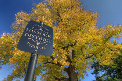 Brilliant fall colors near a sign marking the Historic District on Main Street in Abingdon, VA on Friday, October 17, 2014. Copyright 2014 Jason Barnette