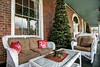 Christmas trees and decor on the outside covered porch at the Martha Washington Hotel & Spa in Abingdon, VA on Tuesday, December 10, 2013. Copyright 2013 Jason Barnette