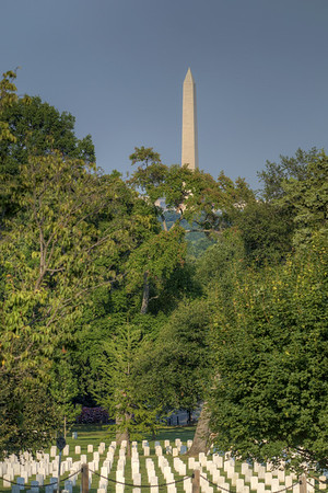 The Washington Monument stands above the trees at Arlington National Cemetery in Arlington, VA on Monday, August 17, 2015. Copyright 2015 Jason Barnette