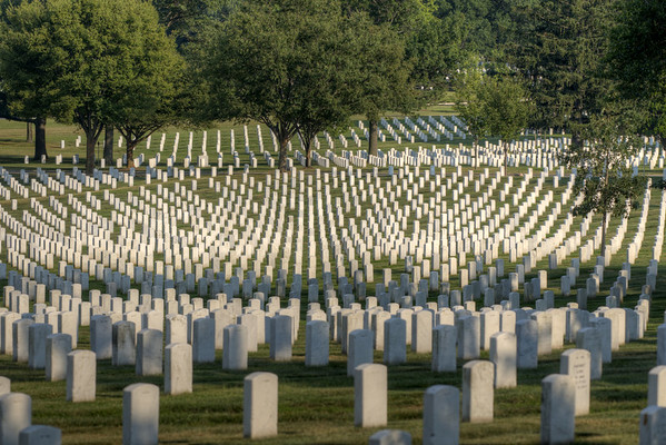 Long rows of grave markers at Arlington National Cemetery in Arlington, VA on Monday, August 17, 2015. Copyright 2015 Jason Barnette
