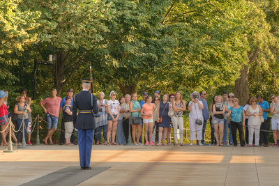 A crowd looks on as a sentinel patrols the area in front of the Tomb of the Unknown Soldier at Arlington National Cemetery in Arlington, VA on Monday, August 17, 2015. Copyright 2015 Jason Barnette