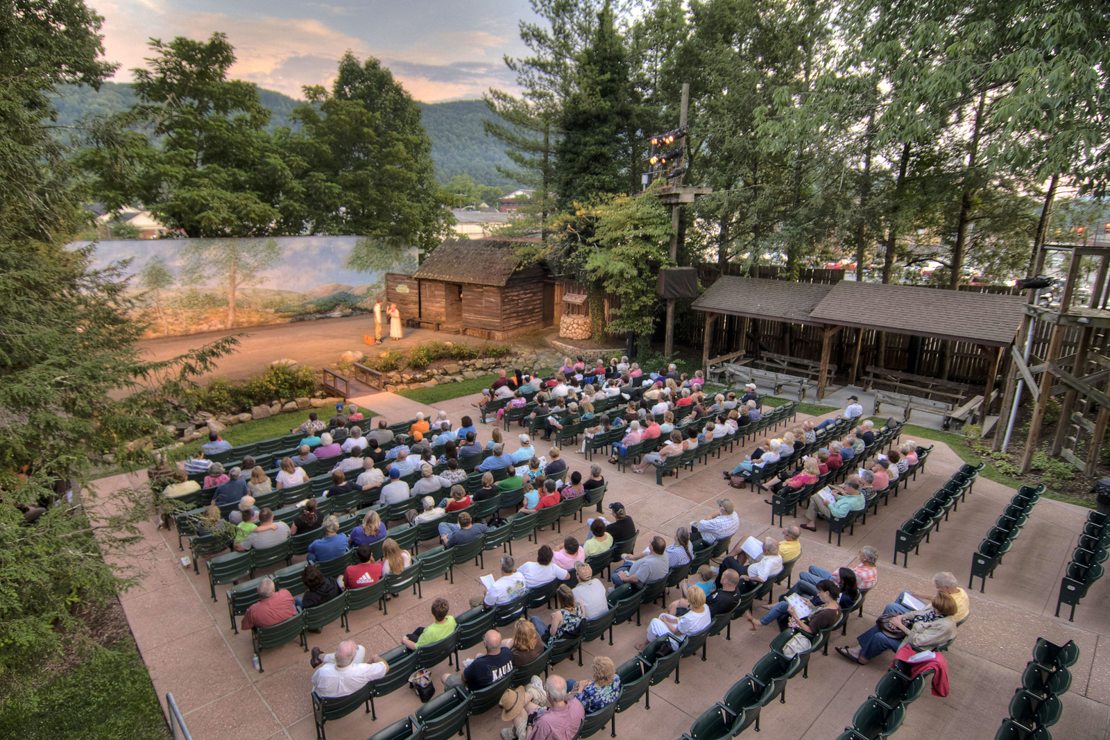 A nearly-full audience watch the outdoor drama, nestled in a valley between mountain ranges, as The Trail of the Lonesome Pine Outdoor Drama held a 50th Anniversary Celebration and Reunion in Big Stone Gap, VA on Friday, July 26, 2013. Copyright 2013 Jason Barnette