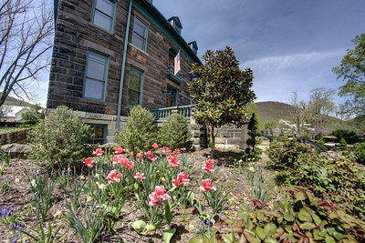 Blooming spring flowers surround the Southwest Virginia Museum Historical State Park in Big Stone Gap, VA on Thursday, April 24, 2014. Copyright 2014 Jason Barnette