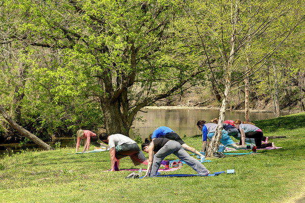 A yoga class takes advantage of the beautiful spring weather and scenery along the Greenbelt Trail in Big Stone Gap, VA on Thursday, April 24, 2014. Copyright 2014 Jason Barnette