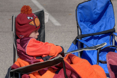 A young boy tries to stay warm at the Cassell Coliseum parking lot as the Virginia Tech University Hokies challenged the Duke University Blue Devils in football at Lane Stadium in Blacksburg, VA on Saturday, October 26, 2013. Copyright 2013 Jason Barnette