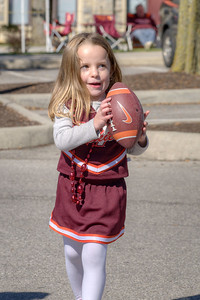 A little girl plays with a football at the Cassell Coliseum parking lot as the Virginia Tech University Hokies challenged the Duke University Blue Devils in football at Lane Stadium in Blacksburg, VA on Saturday, October 26, 2013. Copyright 2013 Jason Barnette