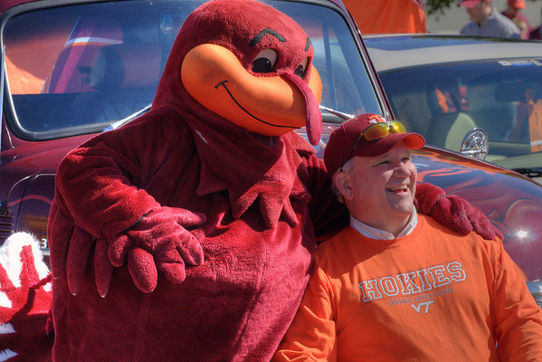 The Hokie Bird mascot poses with Bill Bowser, class of '76, on his 1954 Chevy at the Cassell Coliseum parking lot as the Virginia Tech University Hokies challenged the Duke University Blue Devils in football at Lane Stadium in Blacksburg, VA on Saturday, October 26, 2013. Copyright 2013 Jason Barnette