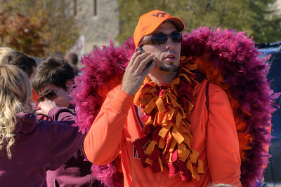 A man with his Hokie wings chats on a phone at the Cassell Coliseum parking lot as the Virginia Tech University Hokies challenged the Duke University Blue Devils in football at Lane Stadium in Blacksburg, VA on Saturday, October 26, 2013. Copyright 2013 Jason Barnette