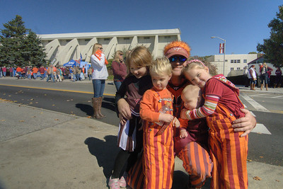 A family dressed for the game, calling themselves A Bunch of Kids at the Duke Game, smile for a shot as the Virginia Tech University Hokies challenged the Duke University Blue Devils in football at Lane Stadium in Blacksburg, VA on Saturday, October 26, 2013. Copyright 2013 Jason Barnette