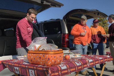 A man grabs some food on a well-decorated tailgating table at the Cassell Coliseum parking lot as the Virginia Tech University Hokies challenged the Duke University Blue Devils in football at Lane Stadium in Blacksburg, VA on Saturday, October 26, 2013. Copyright 2013 Jason Barnette