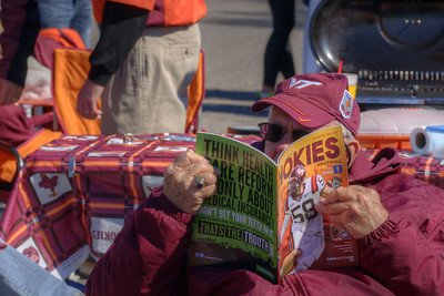 A man reads the program before the game at the Cassell Coliseum parking lot as the Virginia Tech University Hokies challenged the Duke University Blue Devils in football at Lane Stadium in Blacksburg, VA on Saturday, October 26, 2013. Copyright 2013 Jason Barnette