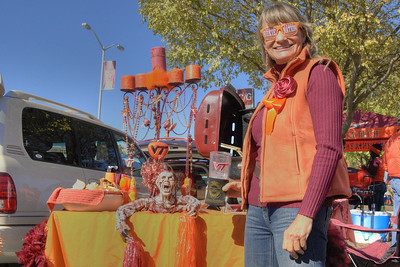 A woman smiles beside her amazingly decorated, Halloween-themed table at the Cassell Coliseum parking lot as the Virginia Tech University Hokies challenged the Duke University Blue Devils in football at Lane Stadium in Blacksburg, VA on Saturday, October 26, 2013. Copyright 2013 Jason Barnette