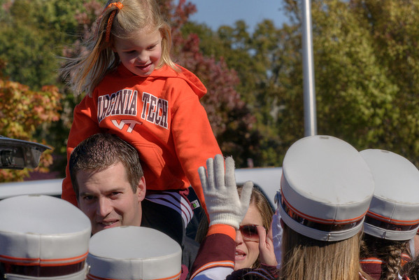 The Marching Virginians give high-fives to a little girl in the Cassell Coliseum parking lot as the Virginia Tech University Hokies challenged the Duke University Blue Devils in football at Lane Stadium in Blacksburg, VA on Saturday, October 26, 2013. Copyright 2013 Jason Barnette