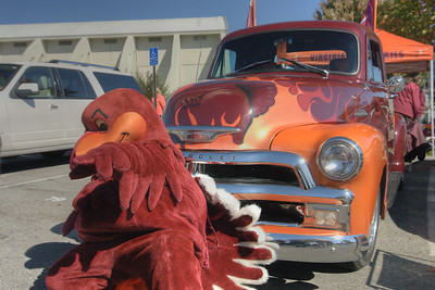 The Hokie Bird mascot poses in front of a beautifully painted 1954 Chevy, owned by class of '76 alumni Bill & Diane Bowser, at the Cassell Coliseum parking lot as the Virginia Tech University Hokies challenged the Duke University Blue Devils in football at Lane Stadium in Blacksburg, VA on Saturday, October 26, 2013. Copyright 2013 Jason Barnette