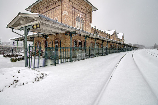 Snow covers the track in front of the historic Bristol Train Station on State Street in Bristol, VA on Thursday, February 13, 2014. Copyright 2014 Jason Barnette  The Bristol Train Station was built in 1902 to serve the booming rail industry and transportation in Bristol. After passenger service was discontinued the space was used for shopping and dining, notably during the 1990's. In 1999 the Bristol Train Station Foundation purchased the building, conducted an extensive renovation, and reopened the building as a rentable space and conference center.