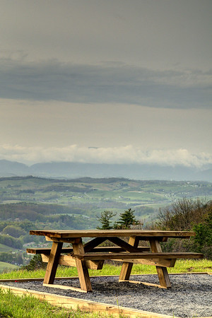 A picnic table with a stunning view of the surrounding mountains and valleys at the Chilhowie Overlook on Whitetop Road near Chilhowie, VA on Monday, April 28, 2014. Copyright 2014 Jason Barnette