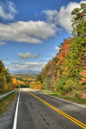The view of fall colors and distant mountains coming down Whitetop Road toward Chilhowie, VA on Sunday, October 19, 2014. Copyright 2014 Jason Barnette