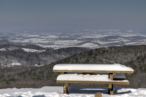 A picnic table covered with snow with a majestic view at the Scenic Overlook on Whitetop Road (Route 762) near Chilhowie, VA on Friday, February 14, 2014. Copyright 2014 Jason Barnette