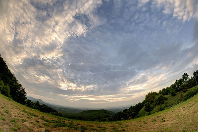 The clouds break open to reveal blue skies just before sunset at the Chilhowie Overlook on Whitetop Road in Chilhowie, VA on Wednesday, July 23, 2014. Copyright 2014 Jason Barnette