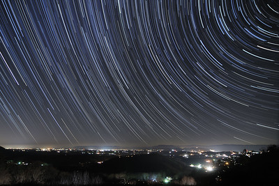 Star trails streak over a darkened sky looking northwest from the Chilhowie Overlook on Whitetop Road in Chilhowie, VA on Friday, November 21, 2014. Copyright 2014 Jason Barnette