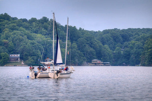 A pair of sailboats tied together during sunset at Claytor Lake State Park in Dublin, VA on Wednesday, July 30, 2014. Copyright 2014 Jason Barnette
