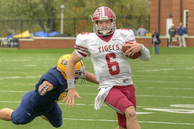 The Tigers' quarterback runs around a defensive player during the Homecoming Football Game as the Wasps took on the Hampden-Sydney College Tigers, at Emory & Henry College in Emory, VA on Saturday, October 19, 2013. Copyright 2013 Jason Barnette