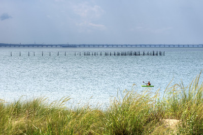 A man kayaks across the water near First Landing State Park in Virginia Beach, VA on Wednesday, August 19, 2015. Copyright 2015 Jason Barnette
