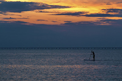 A lone paddleboarder moves across the ocean after sunset near First Landing State Park in Virginia Beach, VA on Wednesday, August 19, 2015. Copyright 2015 Jason Barnette