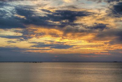 Colors paint the sky over the Chesapeake Bay Bridge-Tunnel near First Landing State Park in Virginia Beach, VA on Wednesday, August 19, 2015. Copyright 2015 Jason Barnette